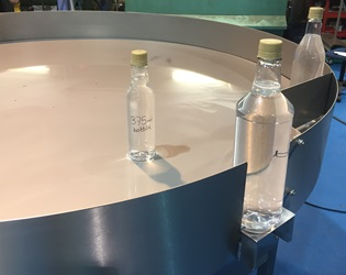 Rotary table with glass bottles