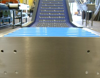 Gravity Roller Conveyor feeding a modular belt elevator