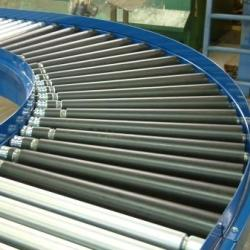 Line shaft conveyor bend